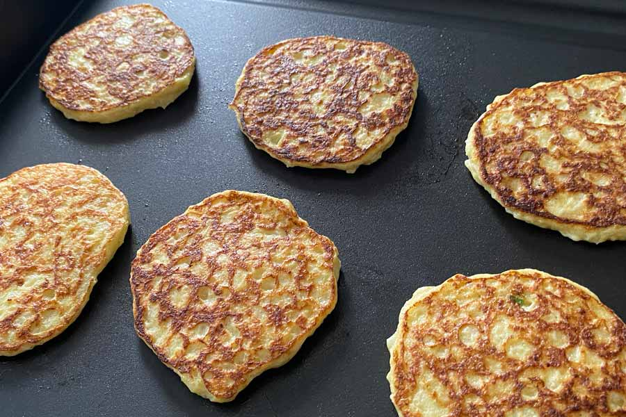 cauliflower patties on griddle