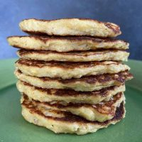 stack of cauliflower patties on green plate