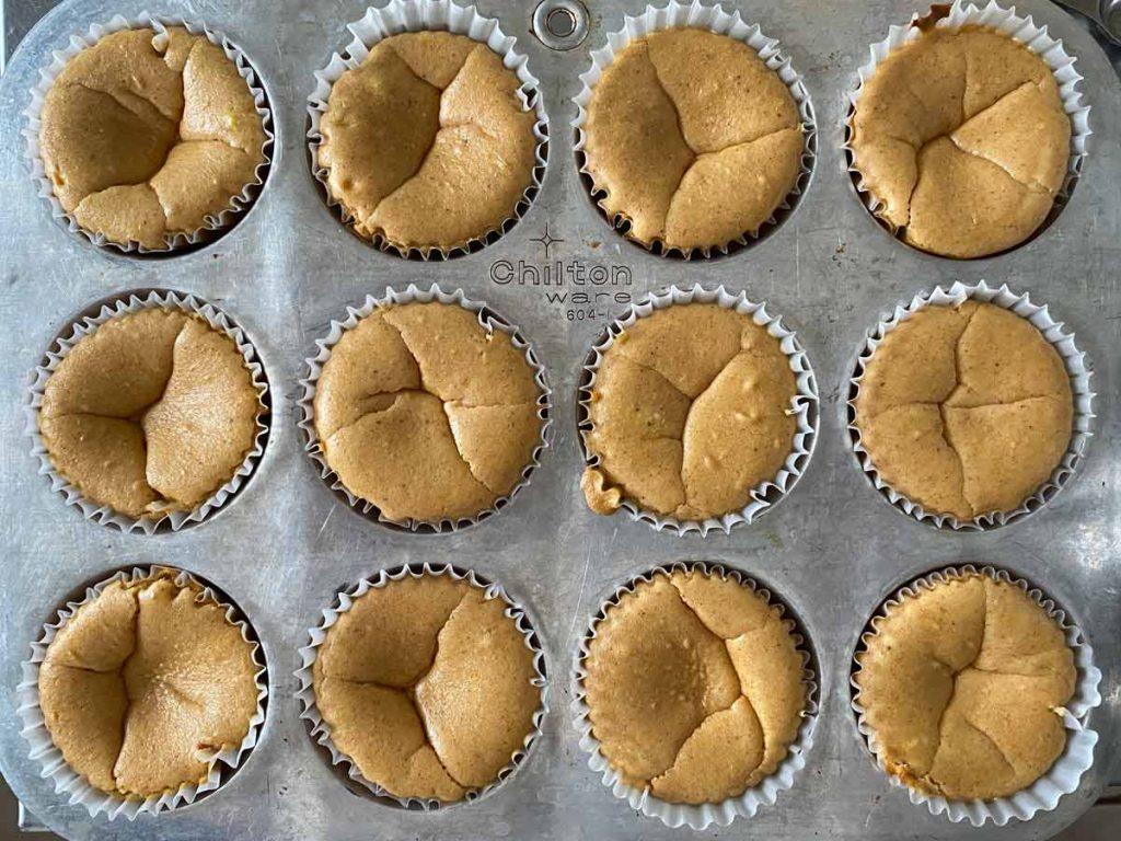 mini pumpkin cheesecakes in muffin tin