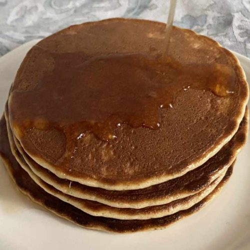 stack of almond flour pancakes with syrup