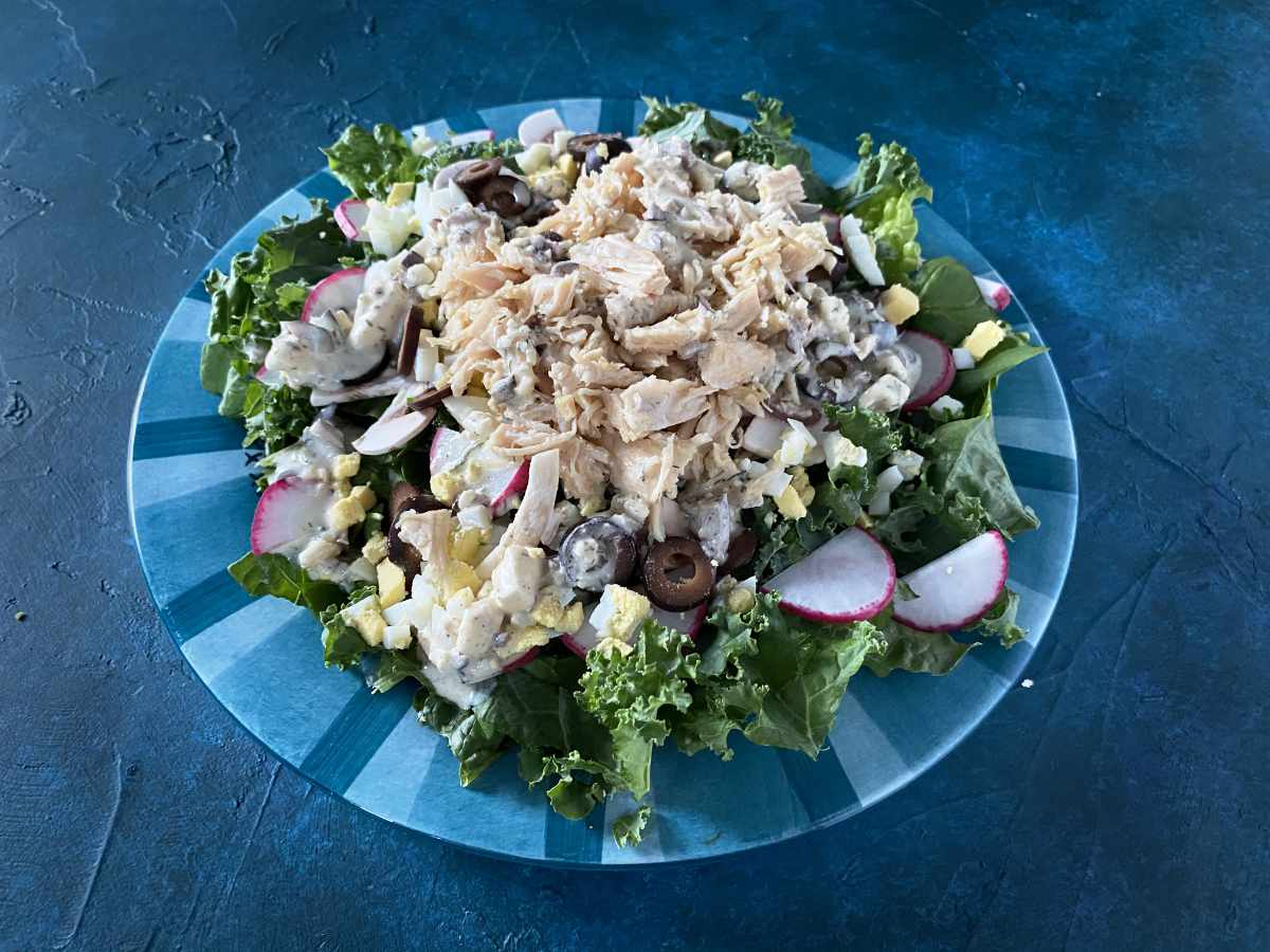 keto salad recipe on blue and green plate