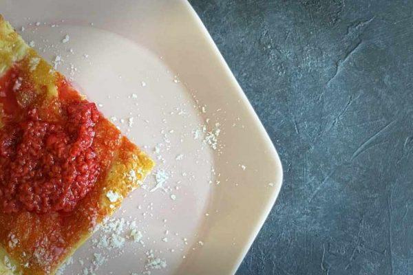 keto dutch baby with raspberries on plate