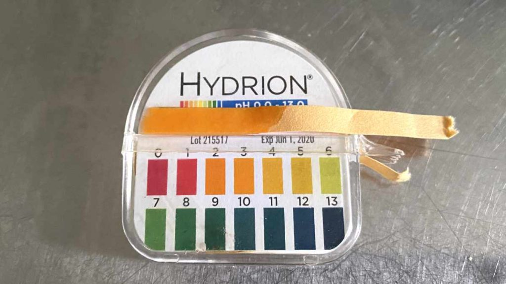PH test strip with chart