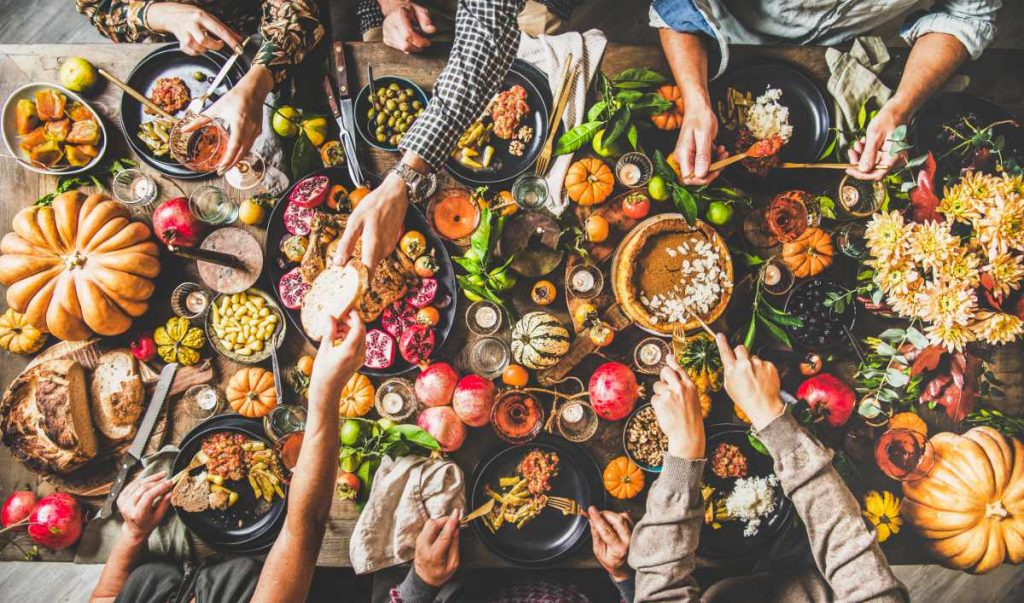 top view of table of food with hands