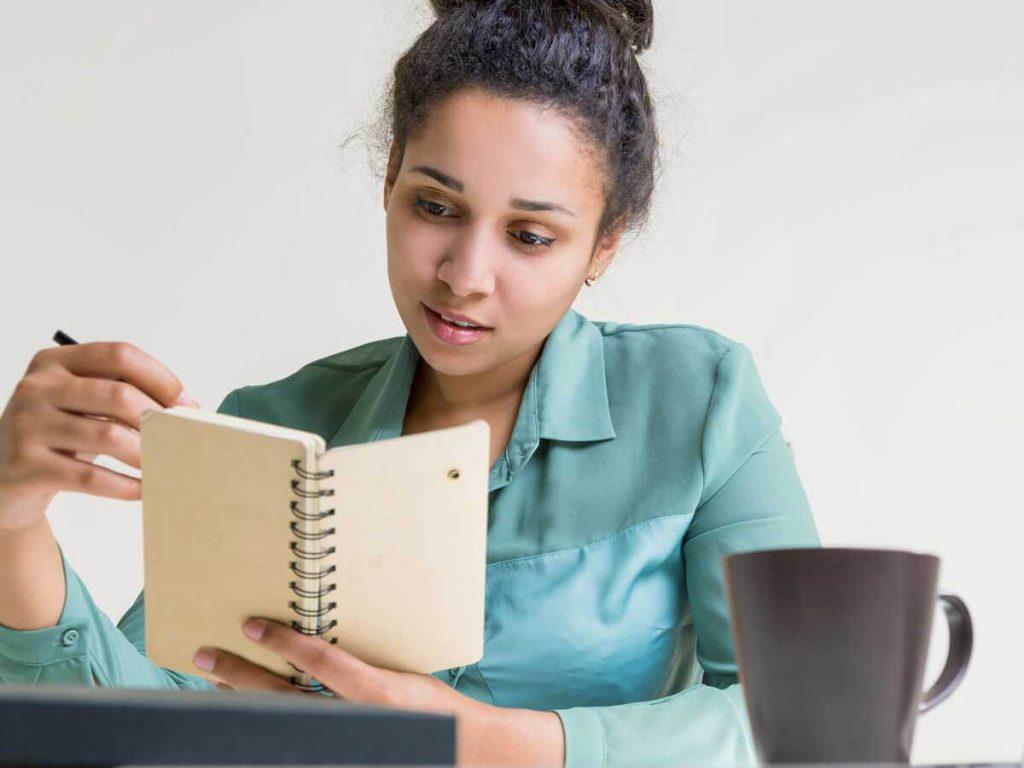 woman pondering journal